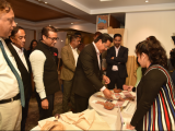 Shri. Conrad Sangma, Hon'ble Chief Minister, Meghalaya looking at exhibition products, at the sidelines of Shillong Dialogue 2019